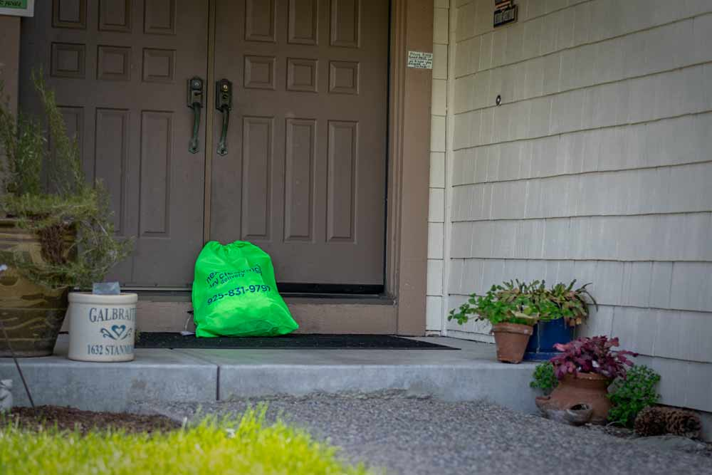 Dry cleaning bag waiting for pickup in Walnut Creek