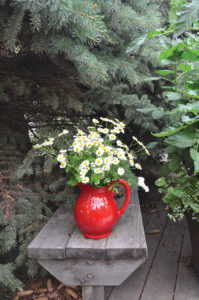 Debbie loves to add unexpected vases full of flowers.