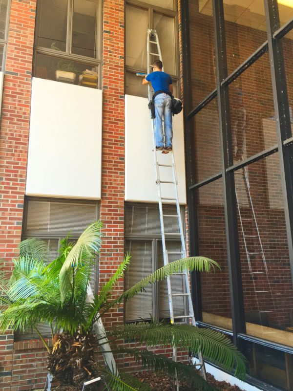 Window washing 3rd floor using ladder