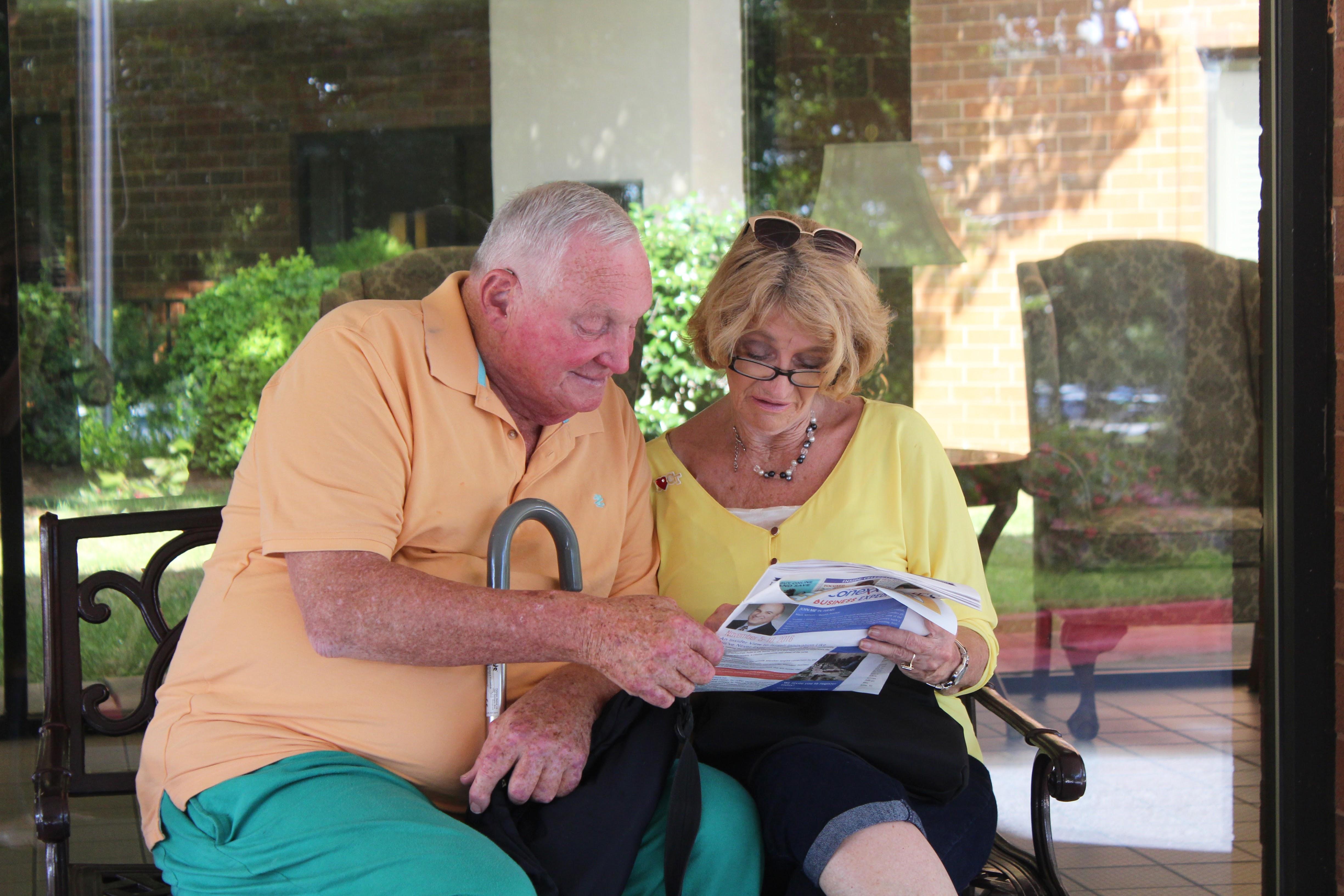 Couple Reading Newsletter