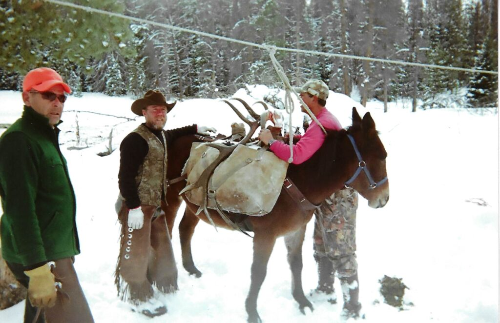 John Troy and Dave Loading Pack Mule