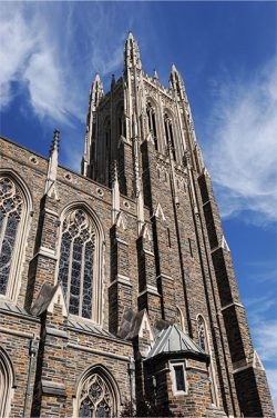 Duke University Church Tower against blue sky with clouds