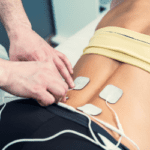 tens therapy applied to back for pain treatment