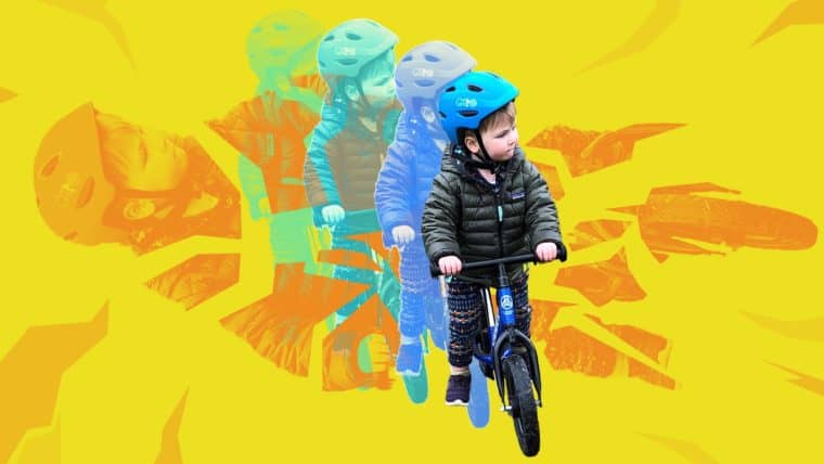 Child riding a bike with a helmet