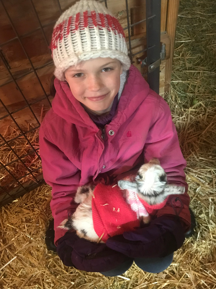 Kid with Baby Goat at Almosta Farm Cove Oregon