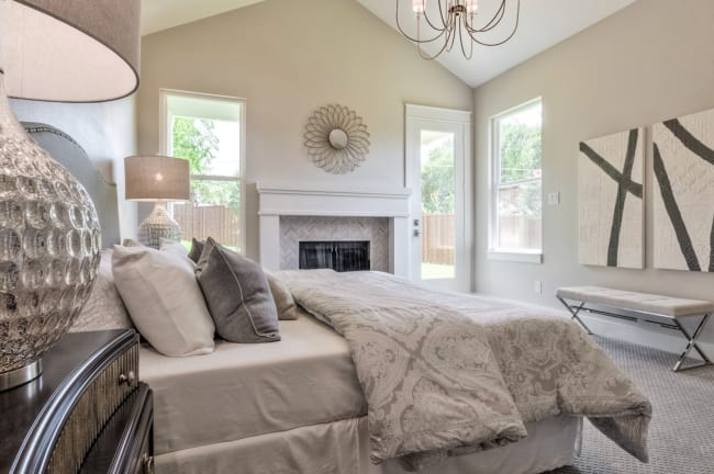 bedroom staged in dallas cream neutral palette home value increased