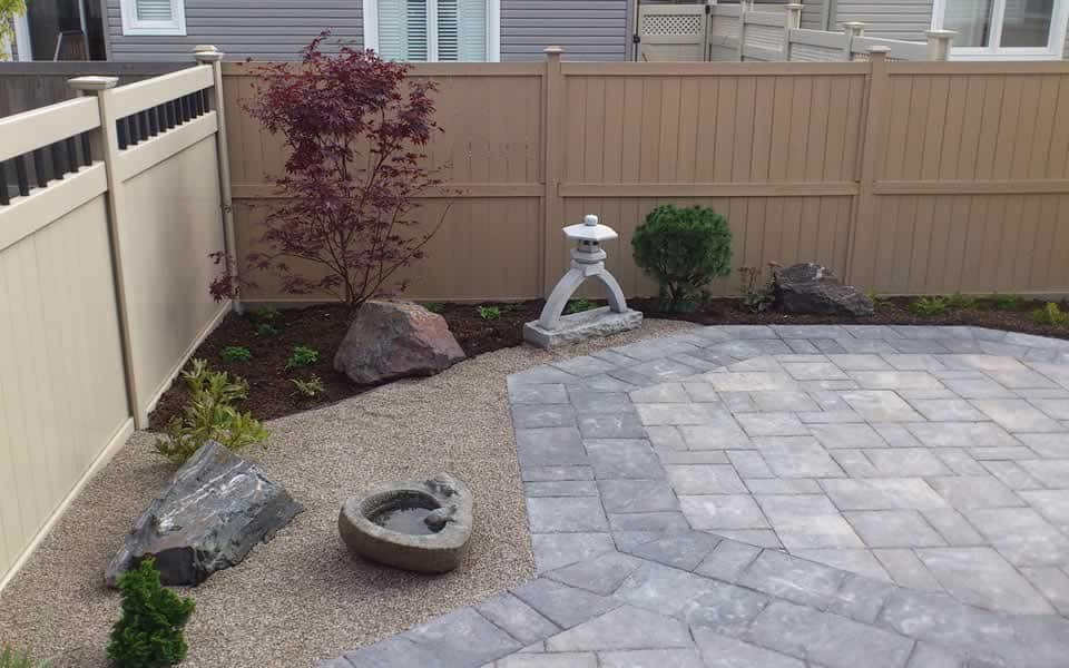 Asian garden with Zen gravel & patio designed by Rhonda Derue installation by Yards Unlimited Landscaping Inc.