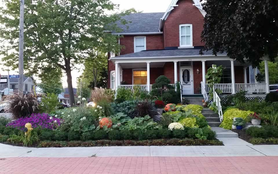 Front yard garden design with mix of veggies and ornamentals