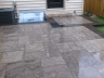 Eramosa limestone patio with Asian black granite accents