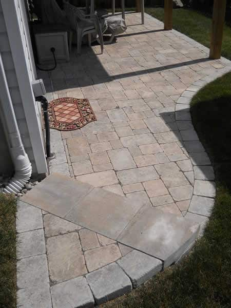 Backyard patio with curved step