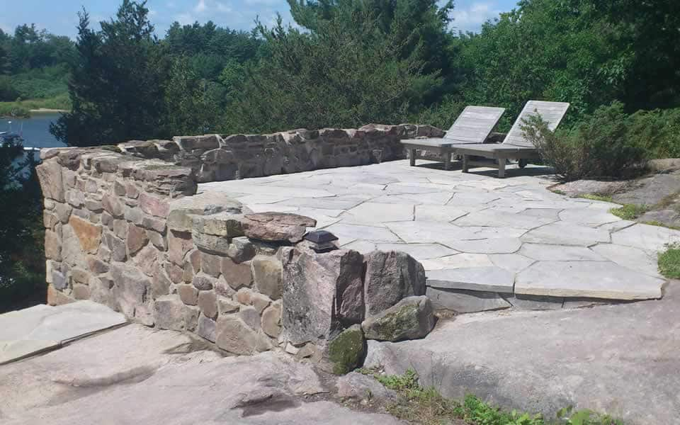 Granite Retaining wall with flagstone patio & steps