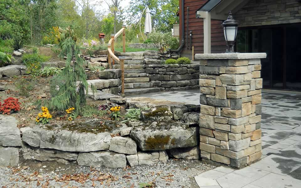 Limestone Ornament Boulders Retaining Plant Bed Levels