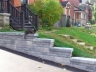 Purrrfectly Cozy Driveway retaining wall designed by Rhonda Derue and installed by Yards Unlimited Landscaping Inc.