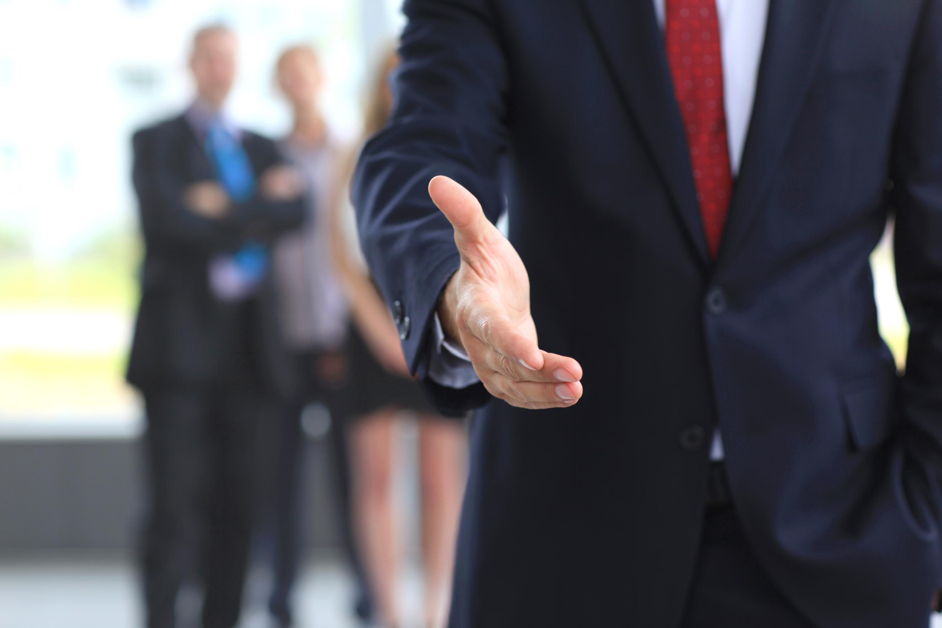business man shaking hands with confidence