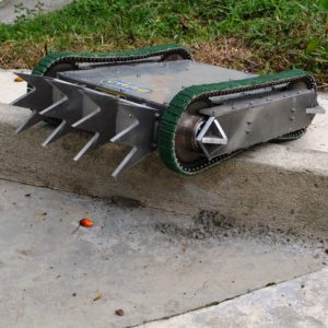 MARK II Combat Robot Project Developed by CRAE TECH Featured Picture. Robot on Concrete Obstacle.