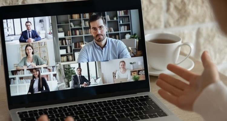 Business people on Zoom meeting on a laptop