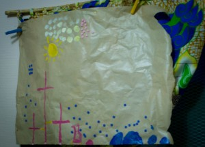 Flower-girl made this to hang in our window to remind us of what we have been given in Christ. We made the paint out of powdered food dye.