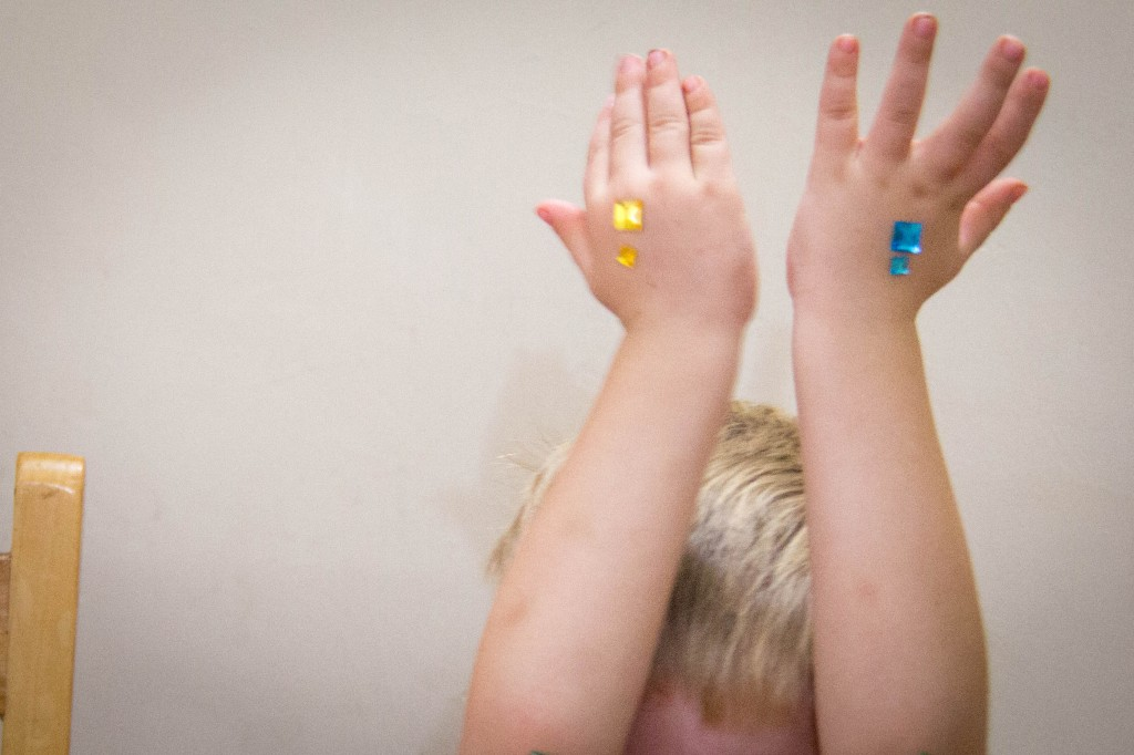 Don't you bedazzle your hands first thing after breakfast? He had help from his sisters...