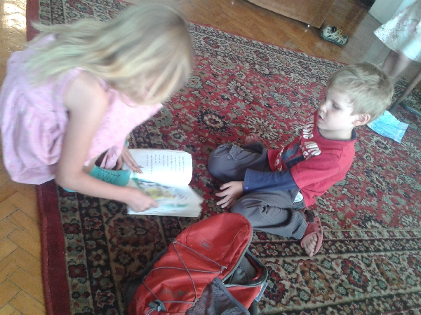 07.11 little sister reading to her brother