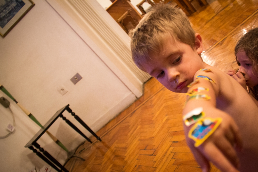 When the eggs dried we got out stickers but D. decided it was much more fun to decorate himself then an egg.
