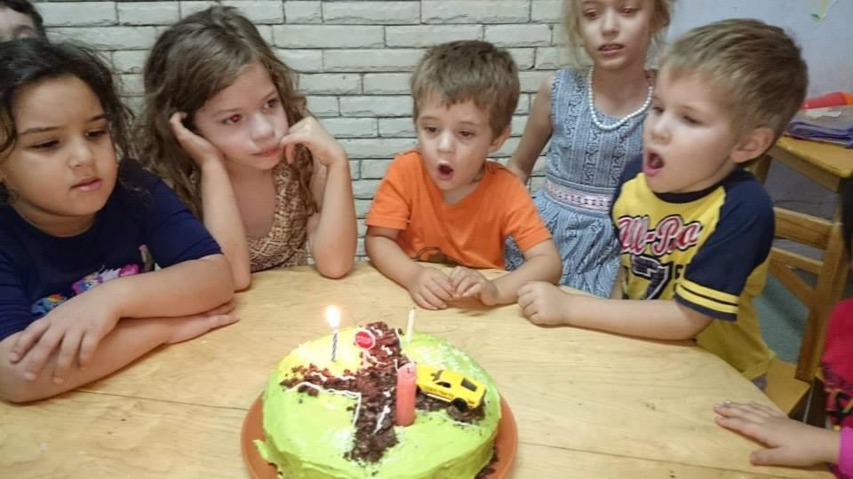 ...and his big sisters even helped him blow out the candles.