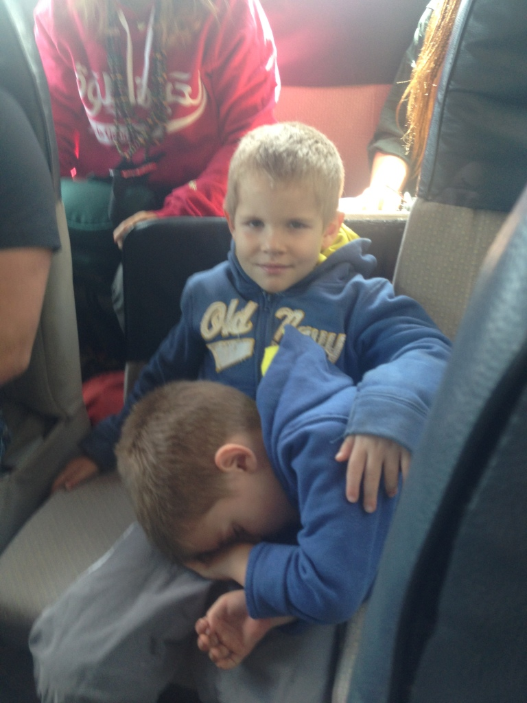 01.21- Sleeping on the way to SLC...his older brother offered him his lap...sweet boy!