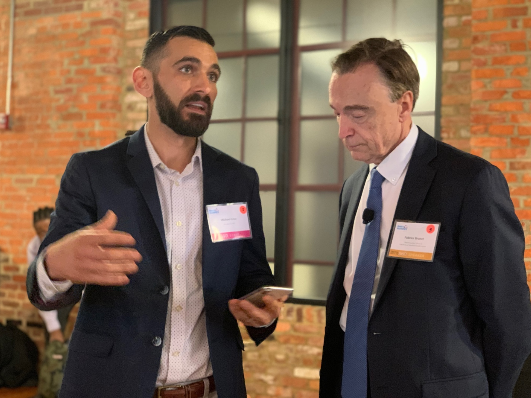 DHIT President Michael Levy with keynote speaker Dr. Fabrice Brunet, President and CEO of University of Montreal Health Centre