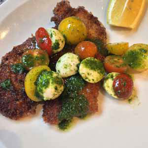 chicken milanese with tomato mozzarella and basil salad