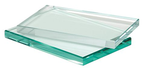 Low-Iron Glass piece laying on top of a regular clear tempered glass piece