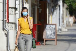 Woman walking with mask on