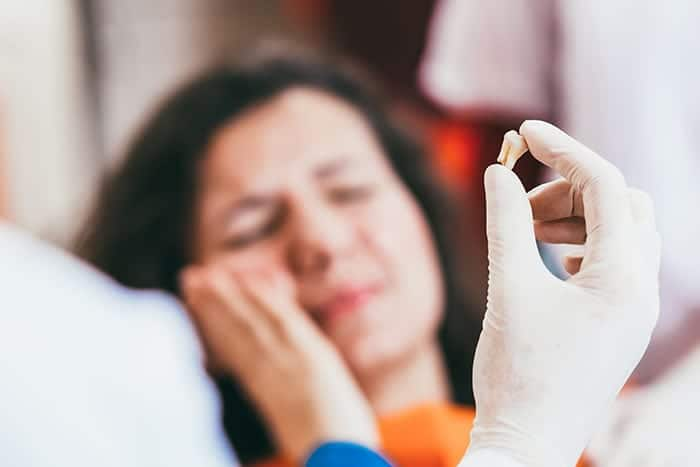 Emergency Dental Care South Tampa Florida - Photo of a woman at the dentist office with a tooth ache.
