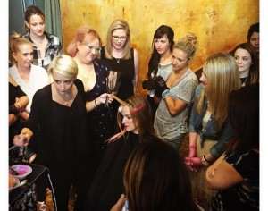 Nicole demonstrating hand painting with Wella's new Magma colors