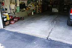 Garage or basement floor slab showing settling cracks