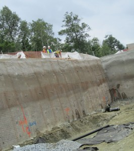 Construction shoring support using helical soil screws with shot crete