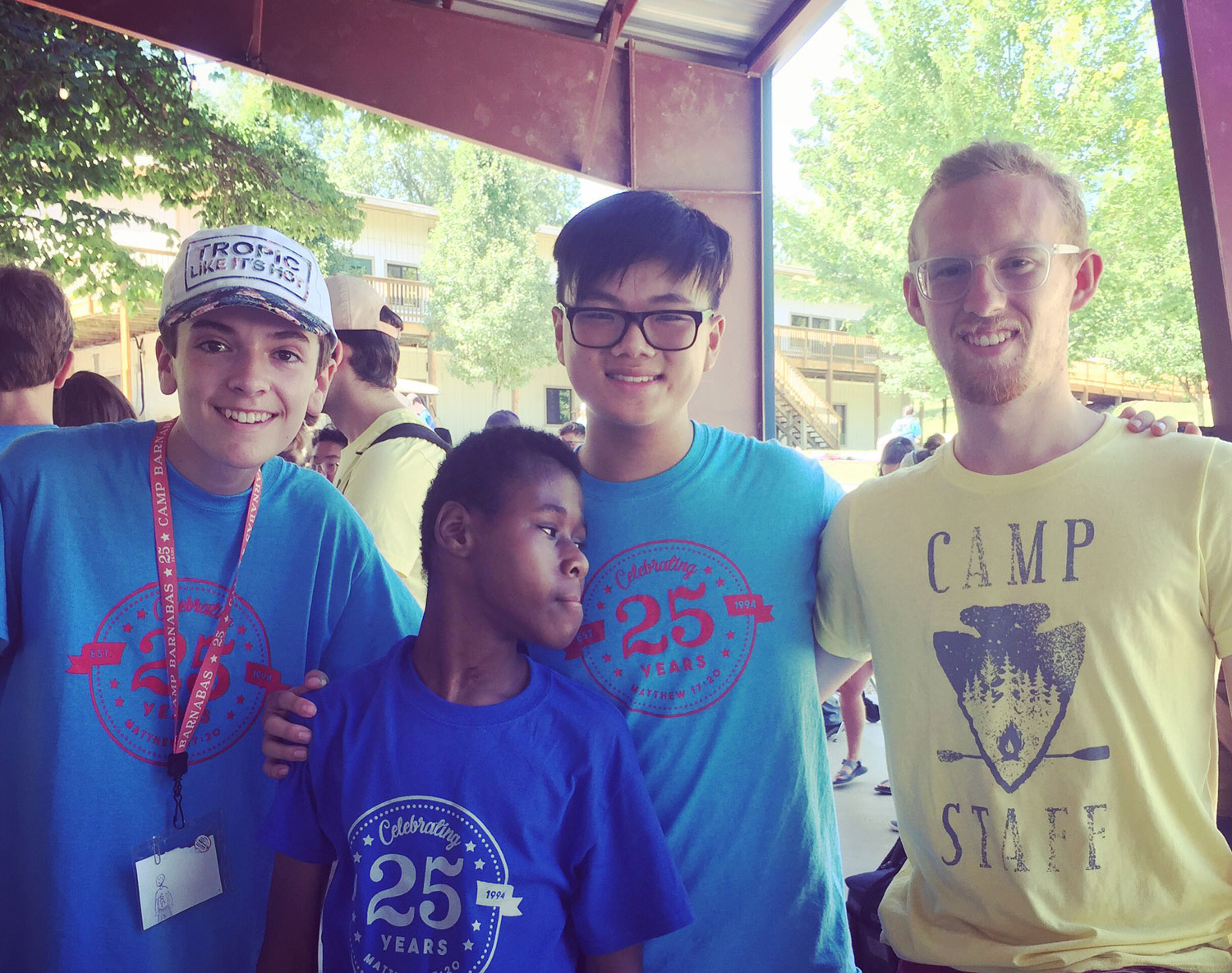 Small group posing together at camp.