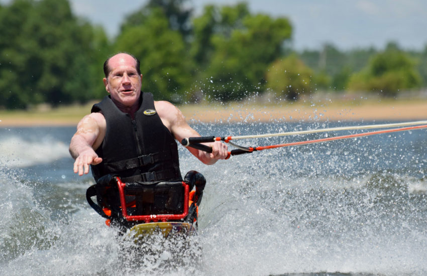 A man is water skiing.
