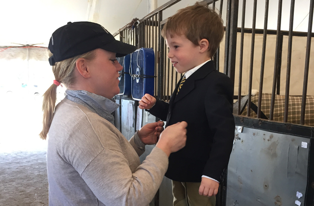 Sara Rhodes helps Aiden Krpan get ready to show!