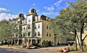 The front of the Bar Harbor Grand Hotel on a sunny day.