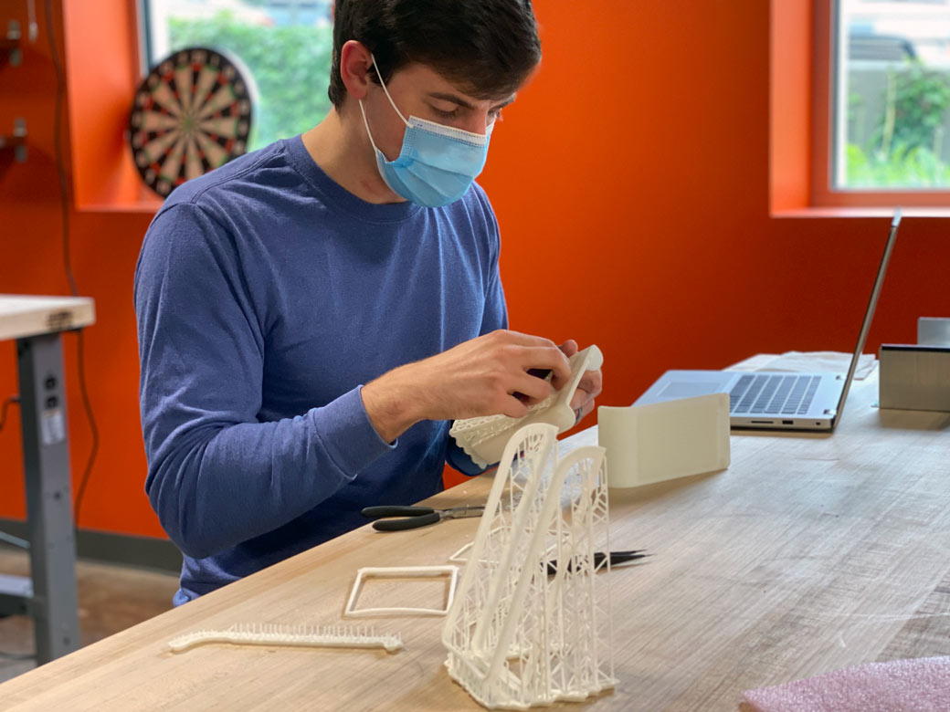 Engenious Design Jobs: Mechanical Engineer Assembling a Prototype