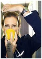 Stewardess demonstrating how to use oxygen mask