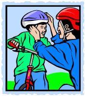 parent putting bike helmet on child
