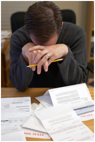 Man overwhelmed by bills, papers