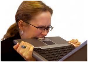 woman-stressed-biting-laptop