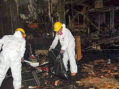 Fire Damage Restoration in Philadelphia, Pa - Technicians Cleaning Up Fire Damage Image