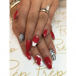 Red fancy nails with black and white details