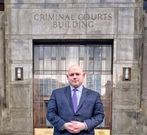 Peter Barta in front of the criminal court building