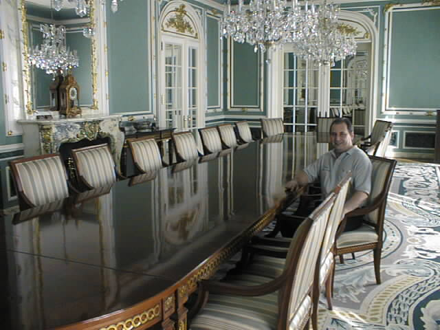 Above, Larry Manoly sits at the table he restored in Alexander Graham Bell's home in Washington, D.C.