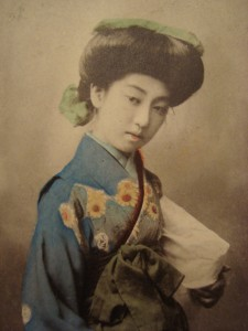 "A coloured photographic postcard of Teruha a famous ""Nine fingered geisha"" popular in the Meiji period"