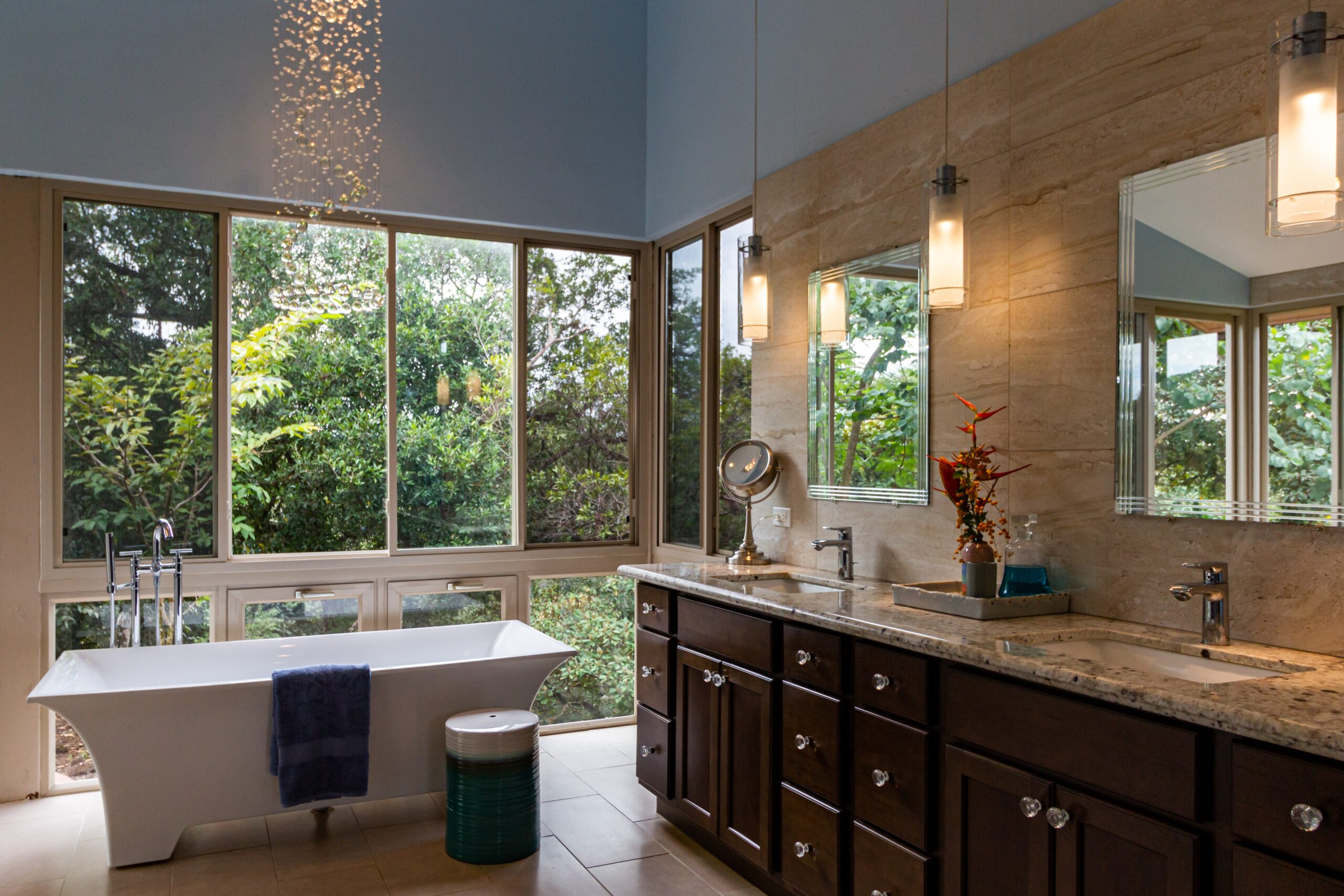Traditional bathroom remodeling done with large windows and stand alone tub