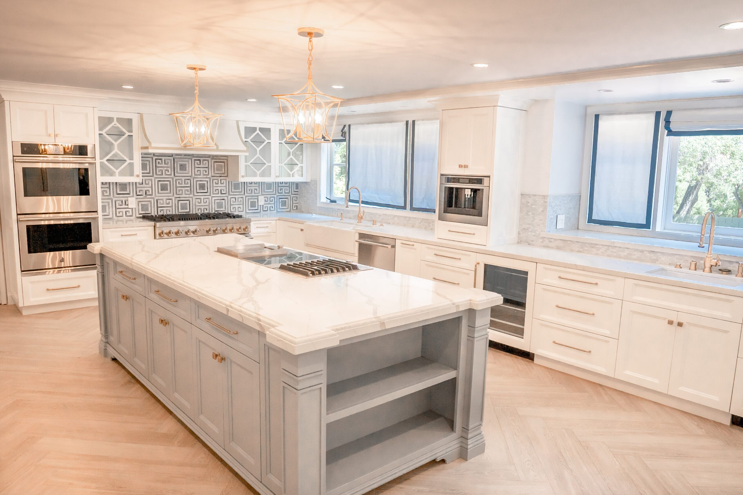Modern kitchen remodeling complete with white cabinets and accent grey island